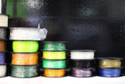 Image of rolls of various 3D printer filaments